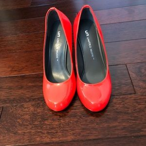 Woman's Red- Orange Heels; brand new.
